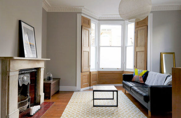 House of Sylphina interior design, Stoke Newington. Grey living room with wooden detail.