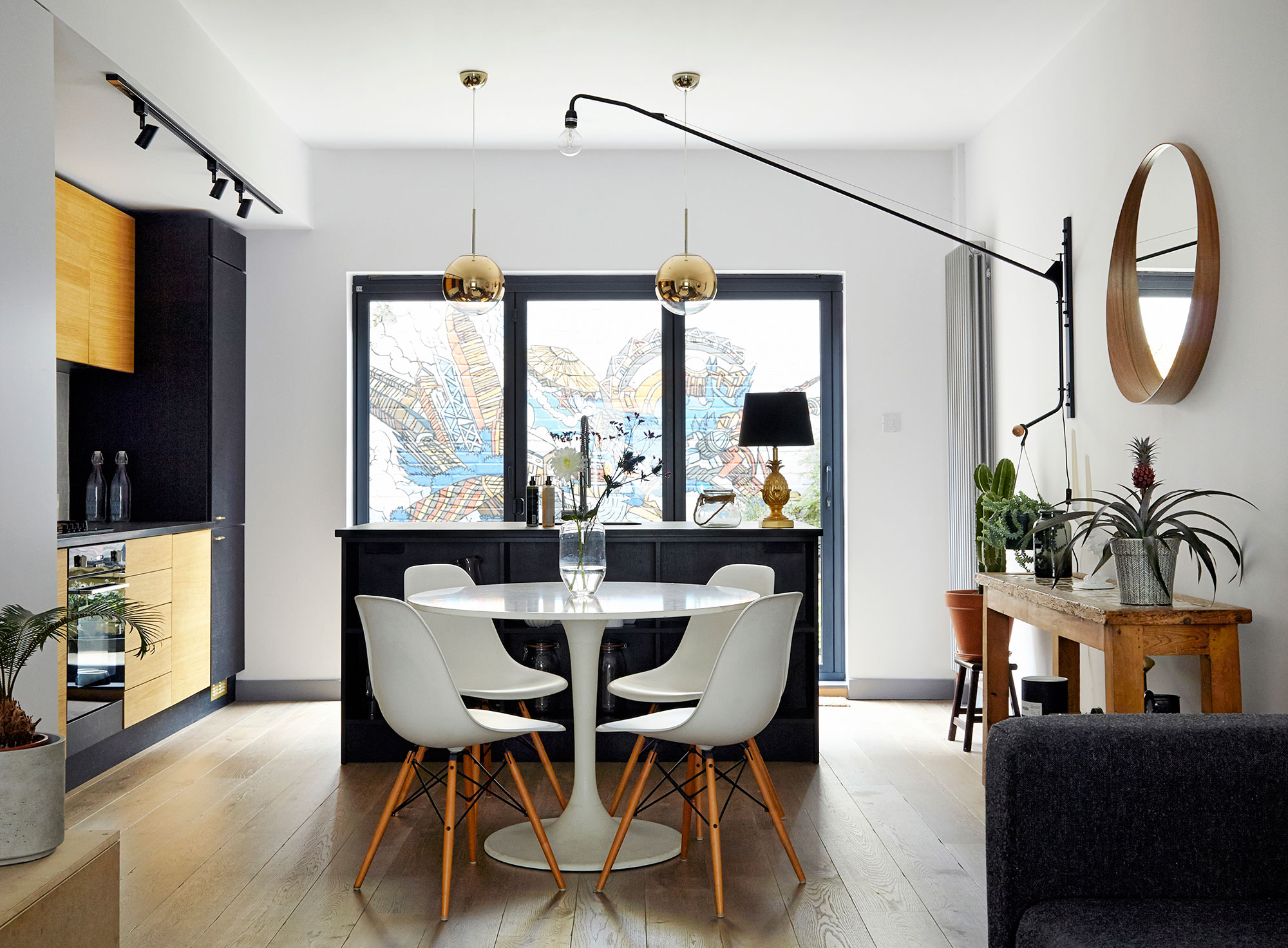 House of Sylphina interior design, Dalston. Monochrome kitchen dining room with gold accents