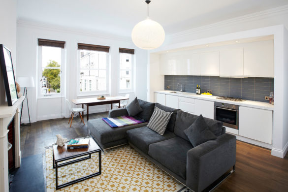 House of Sylphina, minimalist interior design, London. Grey living room with mustard accents.
