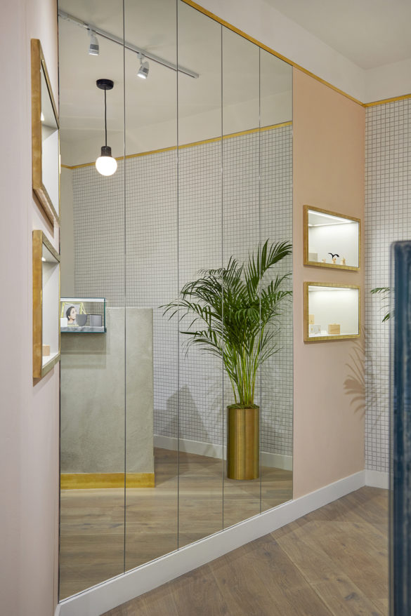 House of Sylphina commercial interior design for Astrid and Miyu flagship, London. Contemporary millennial pink showroom with plants and gold trim.