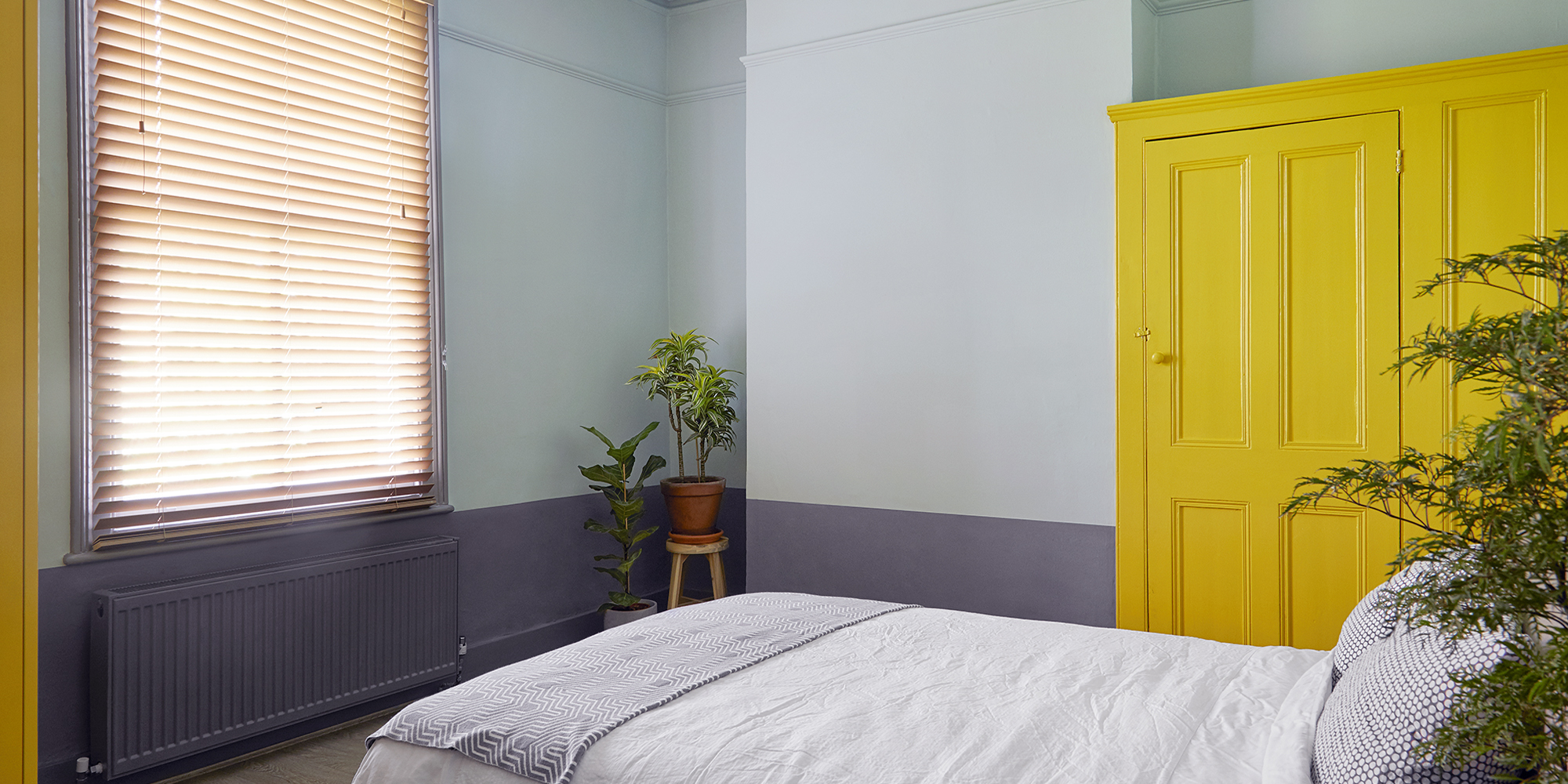 House of Sylphina London interior design - restaurant design, hotel design, shop design, retail design, hospitality design and workspace design. Bold yellow wardrobes in a neutral bedroom