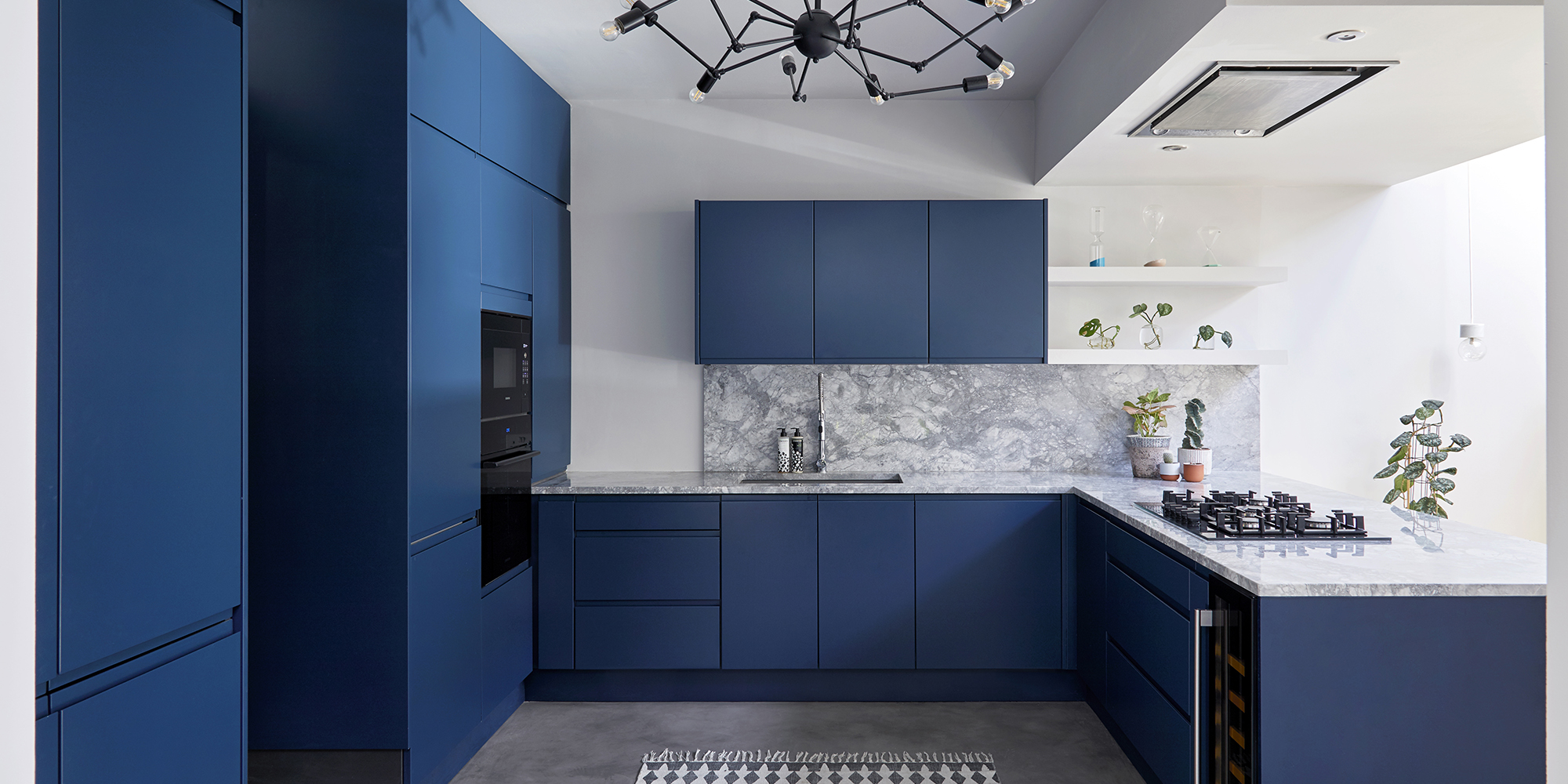 House of Sylphina London interior design - restaurant design, hotel design, shop design, retail design, hospitality design and workspace design. Striking blue and white kitchen